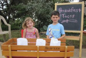 Malia and Owen Shafer with their taco wagon.